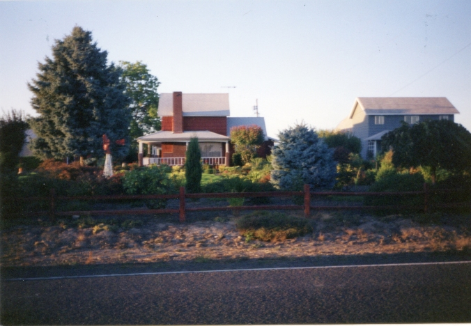Side view of the True Place which includes a view of the home next door (right side of photograph) that Mr. True's family lived in.